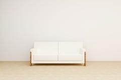 Ljus soffa i rummet Arkivbild