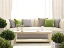 Ljus terrass med soffan och blommor Fotografering för Bildbyråer