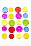 Ljusa blandade knappar, arkivbild