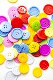 Ljusa blandade knappar, royaltyfria bilder