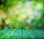 Ljusa bokeh och trä däckar Arkivfoton