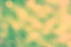 Ljusa fläckar för grön och gul abstarct Royaltyfria Bilder