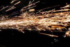 Ljusa gnistor av metall arkivfoton