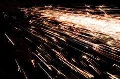 Ljusa gnistor av metall arkivbild