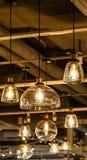 Ljusa kulor som hänger från taket royaltyfria bilder