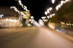 Ljusa linjer för suddigt abstrakt glöd Rörelseljus från att flytta den snabba bilen royaltyfri bild
