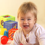 ljusa lyckliga litet barntoys Arkivbilder