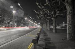 Ljusa strimmor i natten av Genève Royaltyfria Bilder