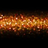 Ljusbakgrund, abstrakt sömlöst suddighetsljus Bokeh som är röd Arkivfoto
