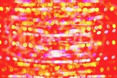 Ljusröd bakgrund för Defocused bokeh Arkivfoto