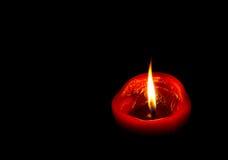 ljusrött stearinljus Arkivfoto