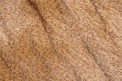 Ljust beige mjukt tyg för textur med abstrakta band Royaltyfri Bild