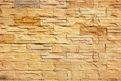 Ljust - den bruna stenväggen texturerar Royaltyfri Bild