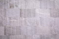 Ljust - grå tegelplatta med modeller i form av fyrkanter arkivbilder