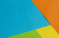 Ljust guling-, gräsplan-, apelsin-, blått- och lilapapper texturerar tillbaka Royaltyfria Foton