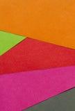 Ljust röd, grön, orange, rosa färg- och svartpapper texturerar backgrou Arkivfoton
