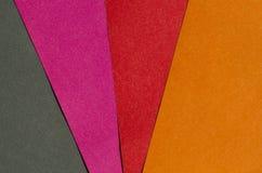 Ljust röd, orange, rosa färg- och svartpapper texturerar bakgrund Royaltyfria Foton