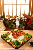 ljust rödbrun veggies för riceräkateriyaki arkivbild