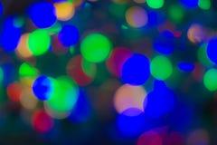 Ljust sken för färgrik bokeh som mousserar den lyxiga tusen dollar som är ljus för bakgrundsskönhetsmedel som annonserar arkivbild
