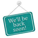 We`ll Be Back Soon Sign. A red and white sign with the words We`ll Be Back Soon isolated on a white background Stock Photo