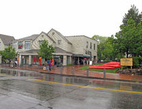 LL Bean flagship store Freeport Maine in rain. People walking in rain at outlet store Royalty Free Stock Images