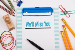 We`ll Miss You. White office desk with stationery Stock Image
