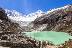 Llaca lagoon in the peruvian Andes and Ocshapalpa peak and Ranrapalca peak. Llaca lagoon (4474 m) in the peruvian Andes and Ocshapalpa peak (5888 m) and royalty free stock images