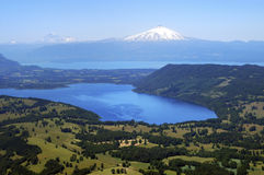 Llaima and Villarrica volcanoes and Lake Villarrica, Chile Stock Photo