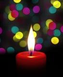 Llama de vela en la noche Imagen de archivo libre de regalías