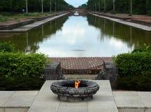 Llama sagrada en el canal central de Lumbini Foto de archivo libre de regalías