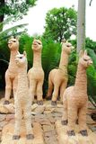 Llama statue. The image of the group of llama statue in garden at Chonburi stock photo