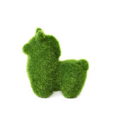 Llama toy Easter decoration isolated. Tiny llama toy statuette made of plastic green grass as a Easter day decoration isolated over the white background Stock Image