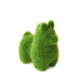 Llama toy Easter decoration isolated. Tiny llama toy statuette made of plastic green grass as a Easter day decoration isolated over the white background Royalty Free Stock Images
