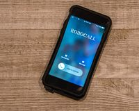 Llamada de la demostración del teléfono celular de, Robocall foto de archivo