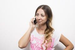 Llamada de teléfono de la mujer Imagenes de archivo