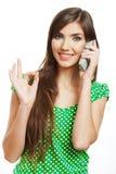 Llamada de teléfono modelo joven femenina Imágenes de archivo libres de regalías