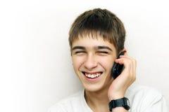 Llamada del adolescente en el teléfono Fotografía de archivo libre de regalías