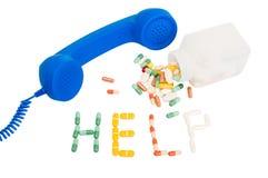 Llamada enviciada píldoras para la ayuda Foto de archivo libre de regalías