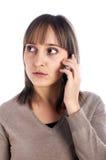 Llamada femenina joven por el teléfono celular Imagen de archivo
