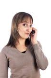 Llamada femenina joven por el teléfono celular Fotografía de archivo