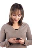 Llamada femenina joven por el teléfono celular Fotos de archivo libres de regalías
