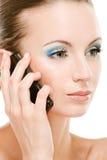 Llamadas de la mujer joven en celular Foto de archivo libre de regalías
