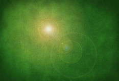 Llamarada verde del sol del fondo de la textura de la piedra del grunge Imagen de archivo