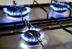 Llamas azules de la estufa de gas Imagenes de archivo