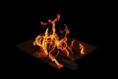 Llamas del fuego en un fondo negro Foto de archivo
