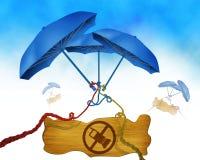 Llame por teléfono al símbolo no permitido en el tablero de madera y el paraguas de tres azules en el fondo binded usando cuerdas Imagen de archivo