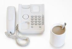 Llame por teléfono del gancho de leva y del café Imagen de archivo libre de regalías