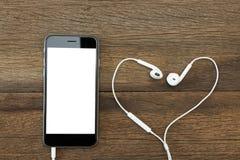 Llame por teléfono a la pantalla y al auricular blancos en la tabla de madera Foto de archivo libre de regalías