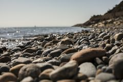 Llanbedrog, North Wales, the UK - the beach and the sea. This image a beach in LLanbedrog, North Wales. It was taken on a sunny day in spring 2018. We can see royalty free stock photos