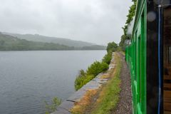 Free Llanberis Lake And Snowdonia Mountains In The Light Rain Seen From Slow Moving Steam Train - 2 Royalty Free Stock Image - 123381106